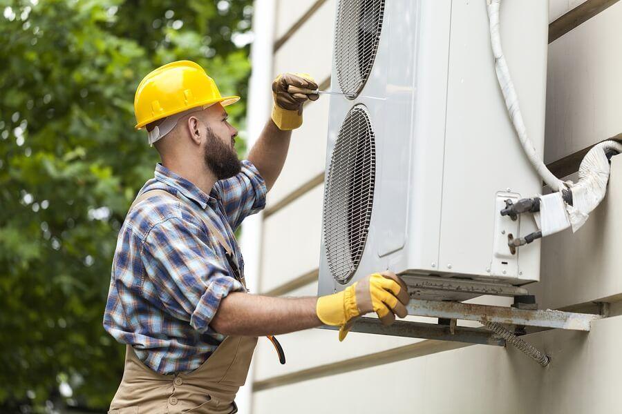 Lone worker repairing HVAC