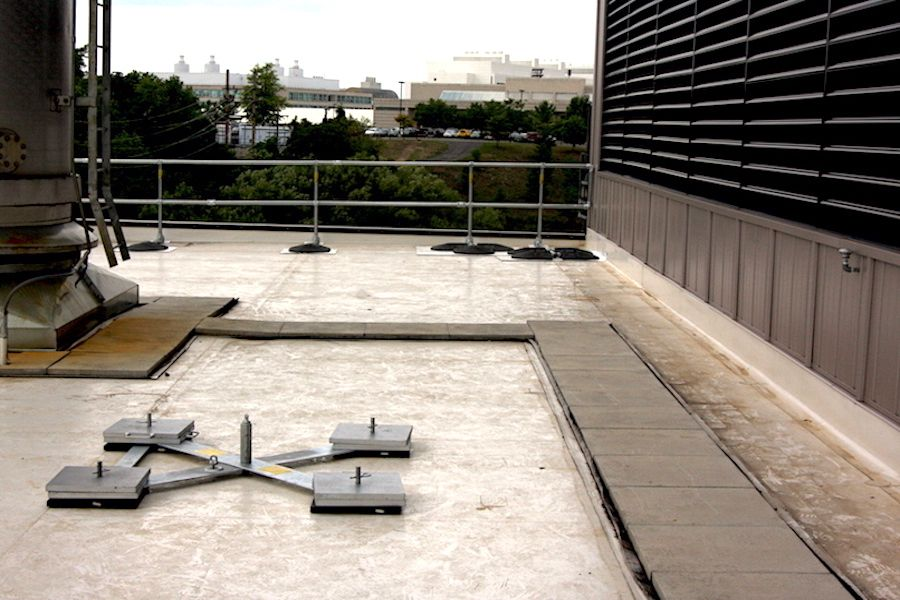 walkway pads on flat roof surface