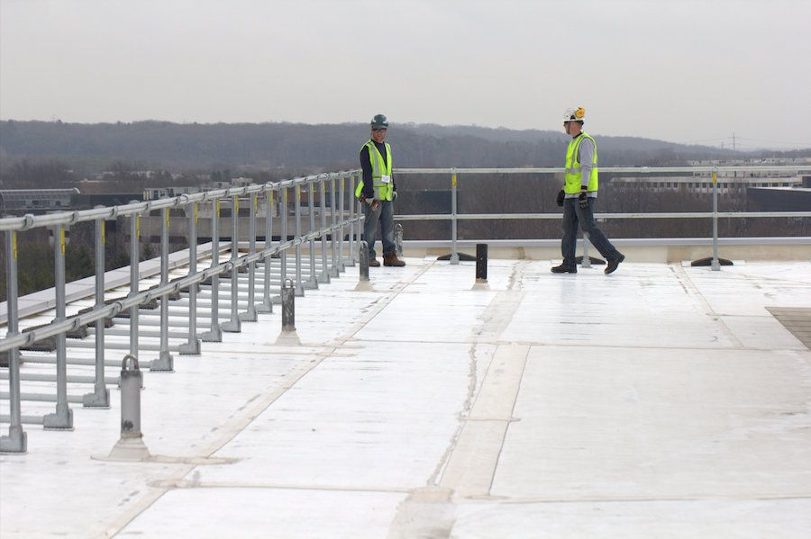 worker rooftop railing